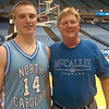 Ken Holland '71 and his son Kyle, a member of UNC's JV basketball team.