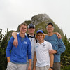 Oliver Benton III '73, his sons Oliver IV '08 and Elliott '11 and former McCallie exchange student Nicolas Roth show off their McCallie colors high in the Swiss Alps.