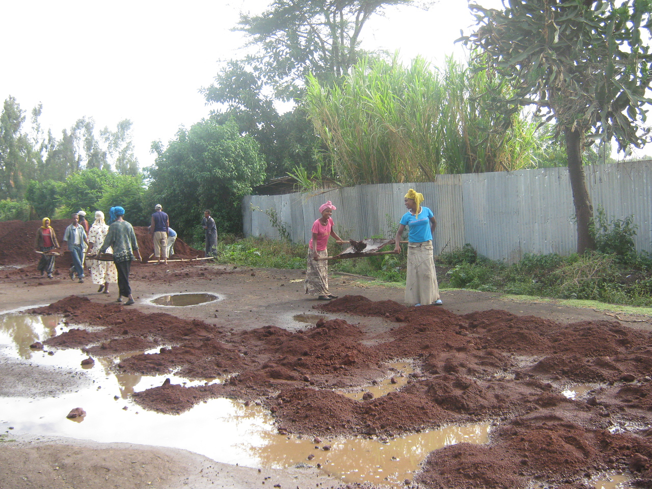 The local area - workers constructing a surfaced road.