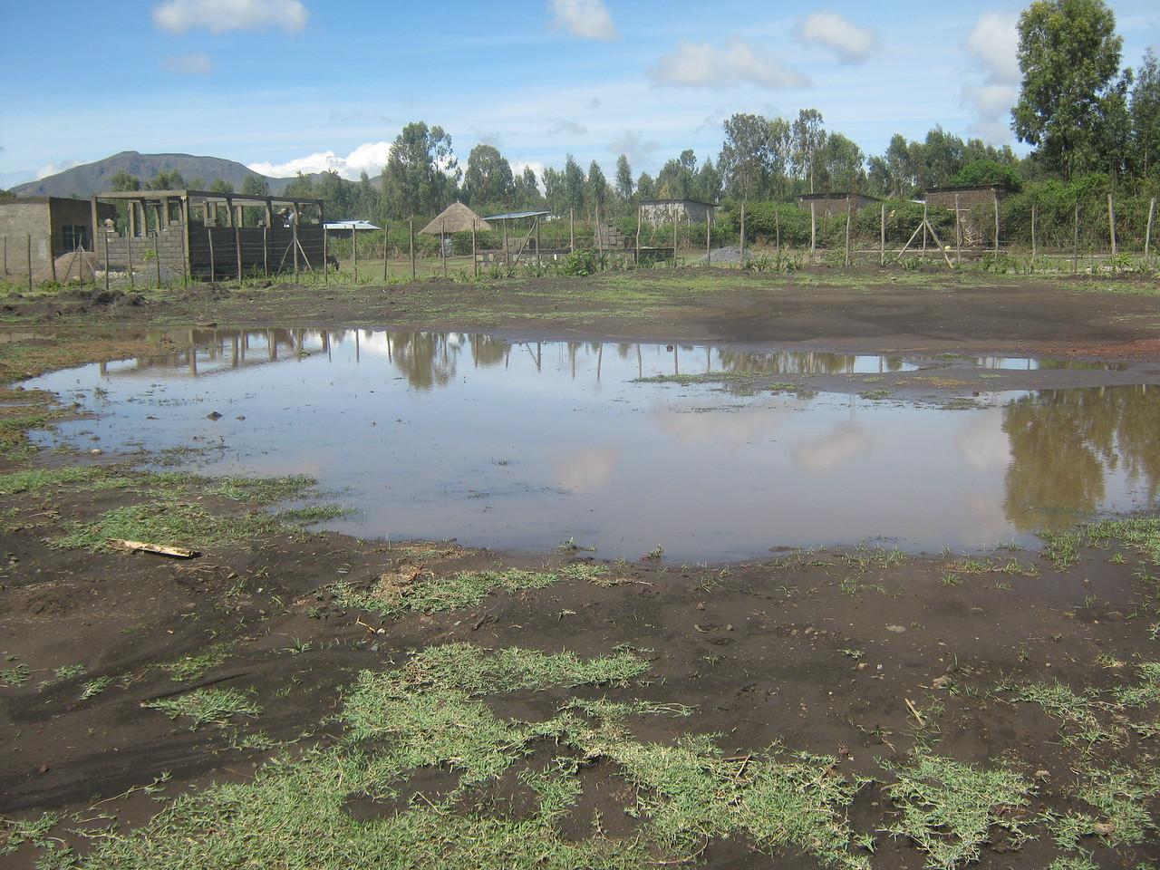 Waterlogged school grounds during the rainy season.