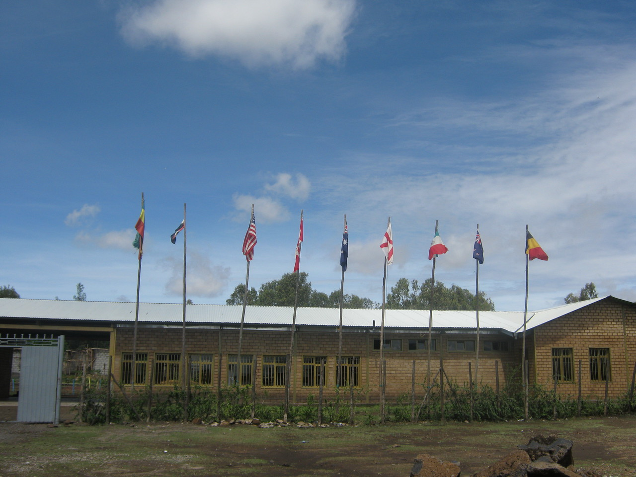 The main school building, with flags.