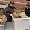 Schools in Fitchburg were still giving out lunches and breakfasts to those students that still need them on Monday, March 23, 2020. At South Street Elementary School they had cereal and chocolate muffins for breakfast. For lunch they made buffalo chicken salad, a yogurt meal and turkey an cheese sandwiches. Michelle McGrath sets up for residents to come and get their lunches at South Street.  SENTINEL & ENTERPRISE/JOHN LOVE