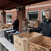 Schools in Fitchburg were still giving out lunches and breakfasts to those students that still need them on Monday, March 23, 2020. At South Street Elementary School they had cereal and chocolate muffins for breakfast. For lunch they made buffalo chicken salad, a yogurt meal and turkey an cheese sandwiches. Beth Gallant waits for residents to come and get their lunches at South Street.  SENTINEL & ENTERPRISE/JOHN LOVE