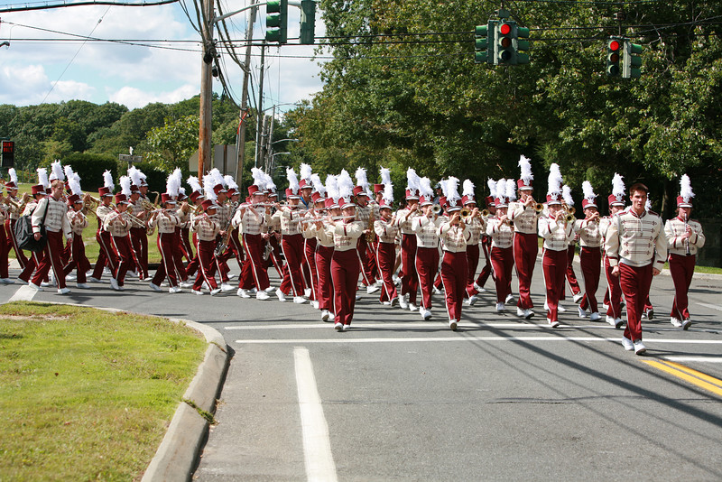 Harrison High School Marching Band, cheerleaders, majorettes,  and color guard