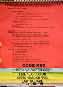 Prinicipal John Shepherd shows a code red sheet which is in every classroom and designates specific actions for different threat levels at Pleasant Valley High School in Chico, Calif. Thurs. April 12, 2018. (Bill Husa -- Enterprise-Record)