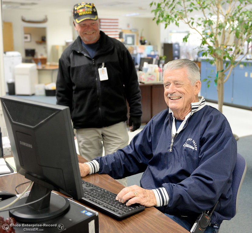 . Campus Supervisors Ray Horn, sitting and Scott Givens smile at the front office at Pleasant Valley High School in Chico, Calif. Thurs. April 12, 2018. (Bill Husa -- Enterprise-Record)