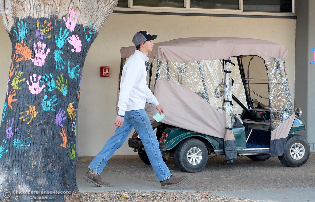 . A student walks through campuse at Pleasant Valley High School in Chico, Calif. Thurs. April 12, 2018. (Bill Husa -- Enterprise-Record)