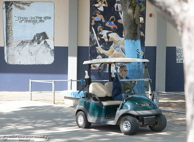 Campus Supervisor Ray Horn uses a golf cart to quickly get around campus as needed at Pleasant Valley High School in Chico, Calif. Thurs. April 12, 2018. (Bill Husa -- Enterprise-Record)
