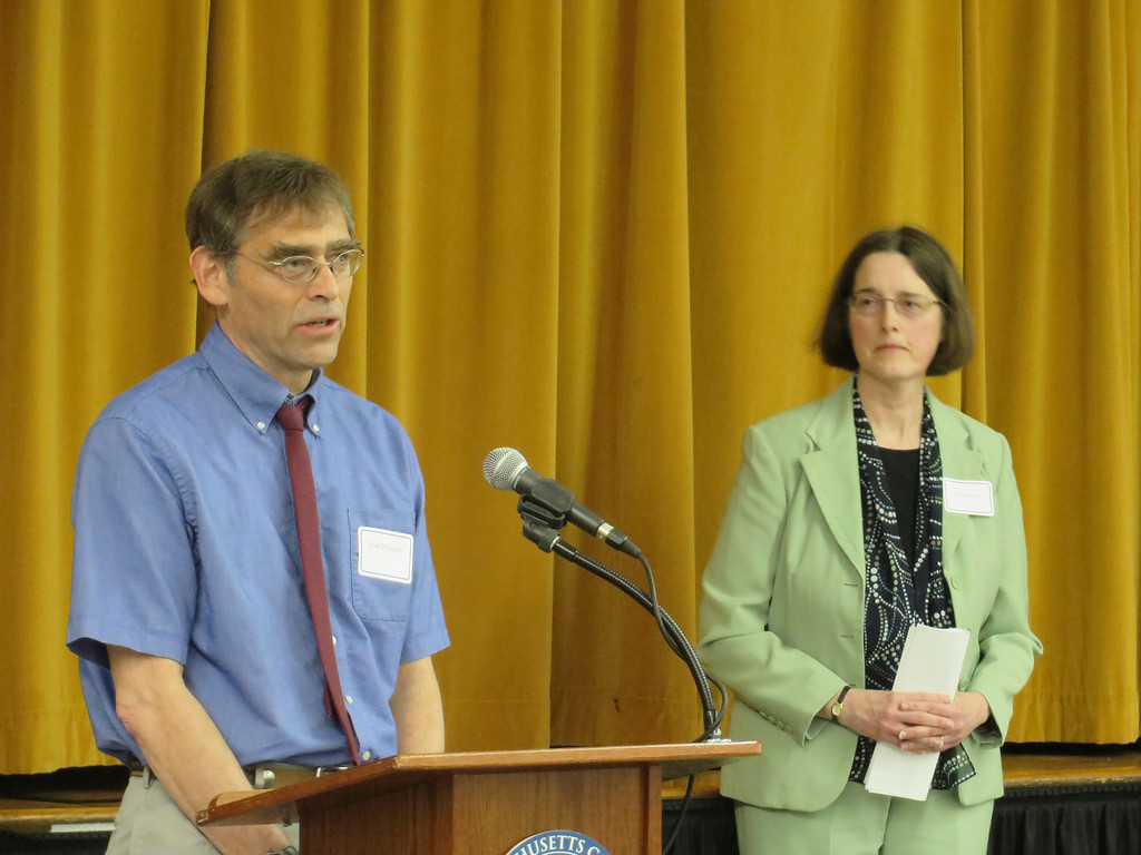 . 2014 Berkshire County Educator Award recipient Dr. Brad Whateley, (left) a physics and mathematics teacher for Pittsfield High School speaks as Cynthia Brown, Massachusetts College of Liberal Arts vice president of academic affairs listens during a May 1 ceremony at MCLA. Jenn Smith/Berkshire Eagle Staff/photos.berkshireeagle.com May 1, 2014