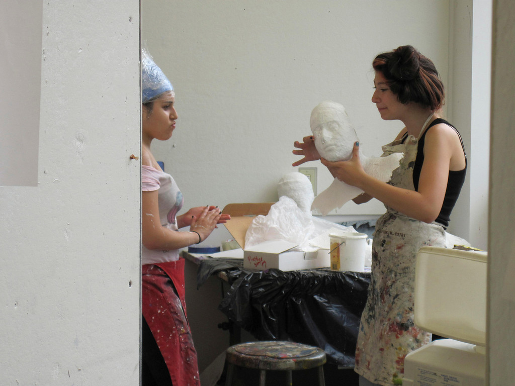 . Eden Zohar (right), 15, shows Dania Birakh, 15, the plaster cast she made of Birakh\'s face. The students are participating in the summer session of Artsbridge, hosted by Buxton School in Williamstown. The program uses art and dialogue to develop constructive partnerships between Israeli, Palestinian and American youth. Sunday, July 21, 2013 Jenn Smith/Berkshire Eagle Staff