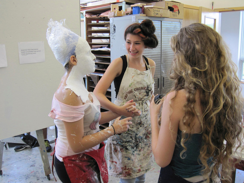 . Eden Zohar leads Dania Birakh, whose head is covered in plaster, through an art studio at Buxton School in Williamstown. The students are participating in the summer session of Artsbridge, which uses art and dialogue to bring Israeli, Palestinian and American youth together. Sunday, July 21, 2013 Jenn Smith/Berkshire Eagle Staff