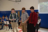 From left, Clarksburg Elementary School graduates and high school students Brian Boudreau, Evan Canales, and Brenden Piaggi, all 14 years old, were awarded The Peter Lee Healthy Communities Award from Cathy O'Connor, right, of the Massachusetts Department of Health on Tuesday, November, 19, 2013, during a school-wide assembly at Clarksburg Elementary School. (Gillian Jones/North Adams Transcript)