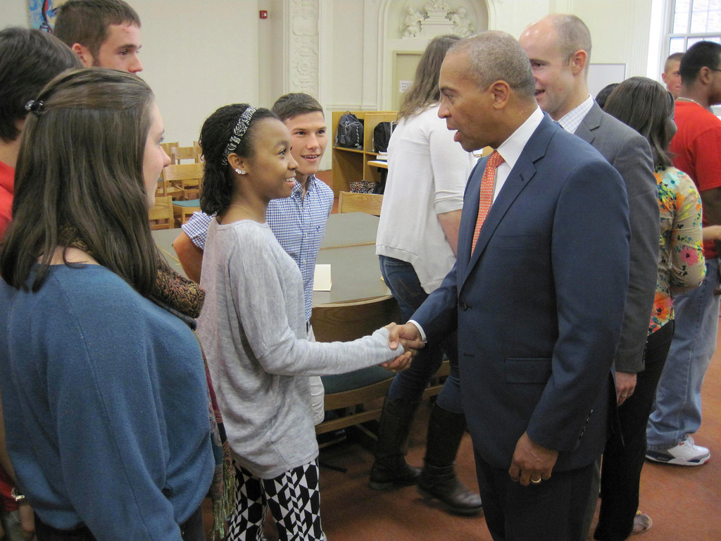 . Pittsfield High School senior Aja Jackson shakes hands with Gov. Deval Patrick, as senior Dimitri Pixley looks on. PHS students met with the governor and other state and local officials during a special roundtable forum held Monday in the school library. Jenn Smith/Berkshire Eagle Staff