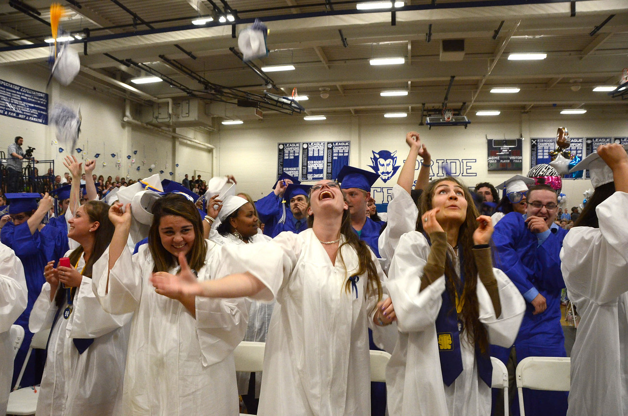 Gillian Jones/North Adams Transcript <br /> Drury High School graduates celebrate after receiving their diplomas with beach balls, confetti and silly string Thursday night during graduation exercises.