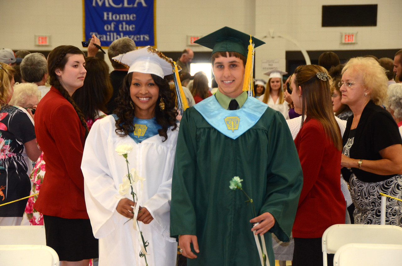 Gillian Jones/North Adams Transcript <br /> McCann Technical High School senior Mary Nguyen and John LeClair process into graduation exercises at MCLA on Wednesday night.