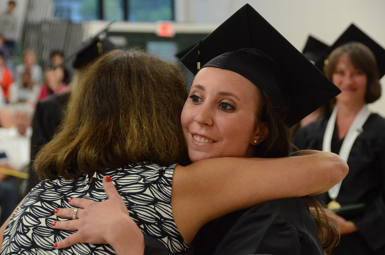 Gillian Jones/North Adams Transcript <br /> Kiersten Sweet hugs Terry LeClair after being pinned as a graduate in the medical assisting program at McCann Technical High School on Monday night.