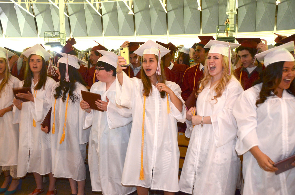 . Graduates react the end of Monument Mountain Regional High School graduation exercises at Tanglewood in Lenox on Sunday, June, 1, 2014. Gillian Jones / Berkshire Eagle Staff / photos.berkshireeagle.com