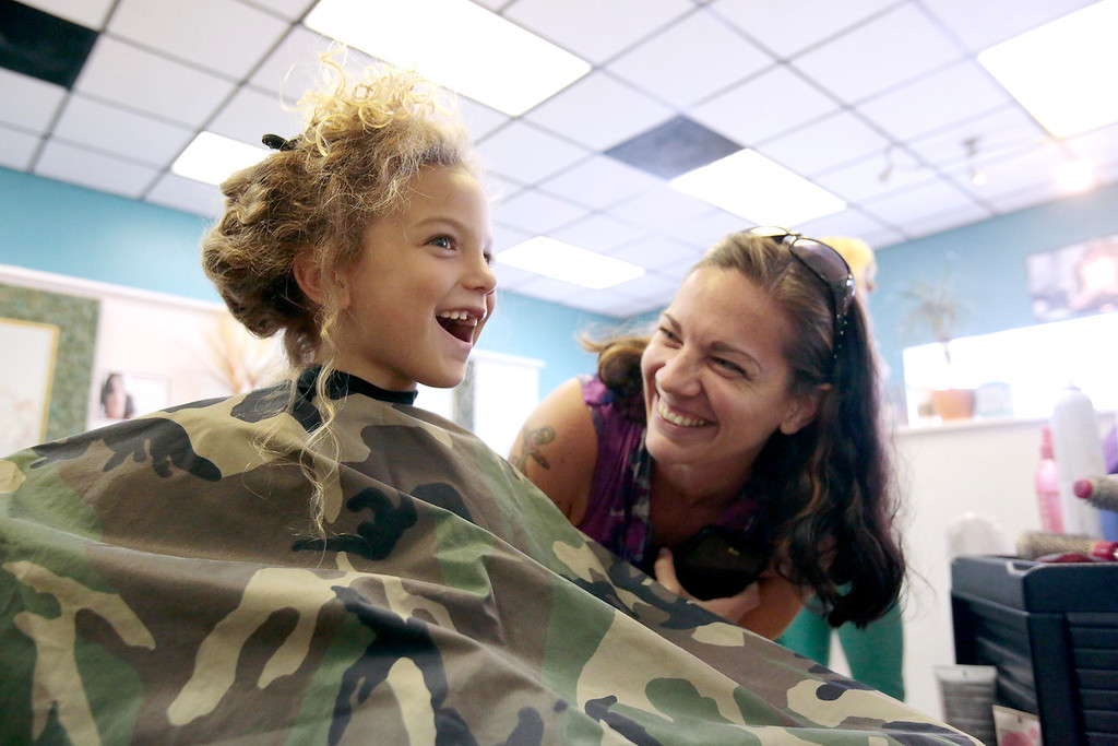 . Sarah DeJesus laughs with her son Kingston 5, just before he gets his first haircut at Split Ends Hair Salon in Pittsfield. Saturday, August 3, 2013. Stephanie Zollshan/Berkshire Eagle Staff.