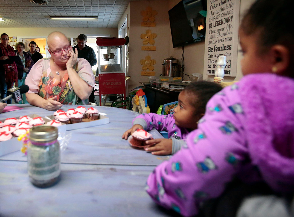 . Sharon Debonis, a cancer victim and recipient of the proceeds from four-year-old twins Emma and Eva Msibi\'s lemonade stand, gets emotional while thanking the girls at Moments House in Pittsfield. Monday, September 23, 2013. Stephanie Zollshan/Berkshire Eagle Staff.