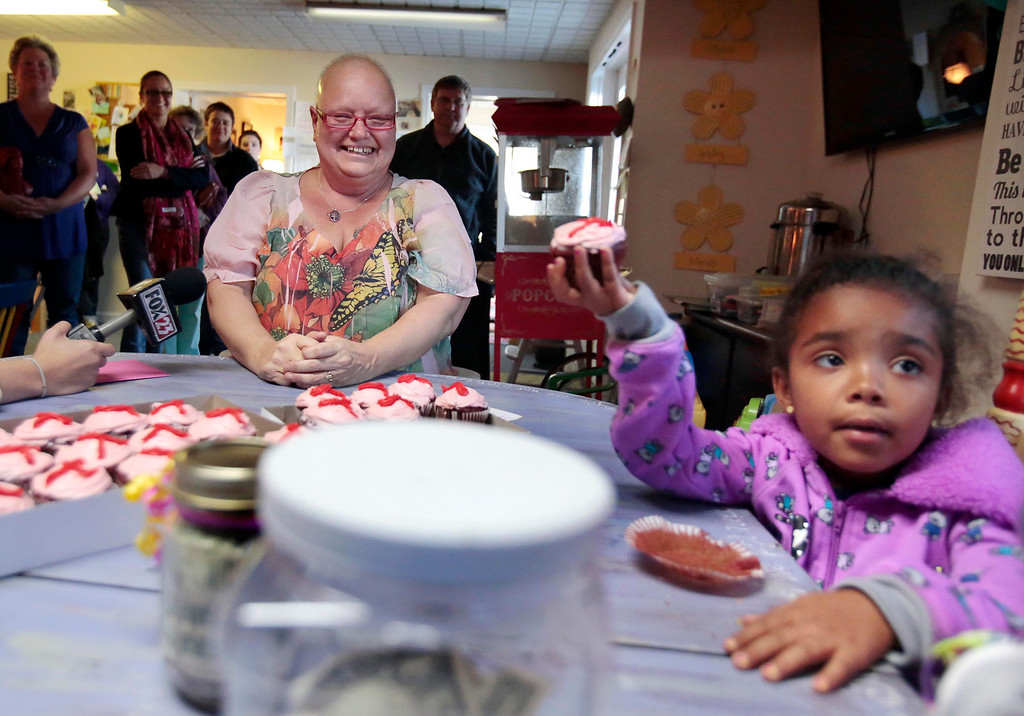 . Emma Msibi, 4, eats a cupcake made for her by Sharon Debonis, a cancer victim and recipient of the proceeds from Msibi and her twin sister Eva\'s lemonade stand at Moments House in Pittsfield. Monday, September 23, 2013. Stephanie Zollshan/Berkshire Eagle Staff.
