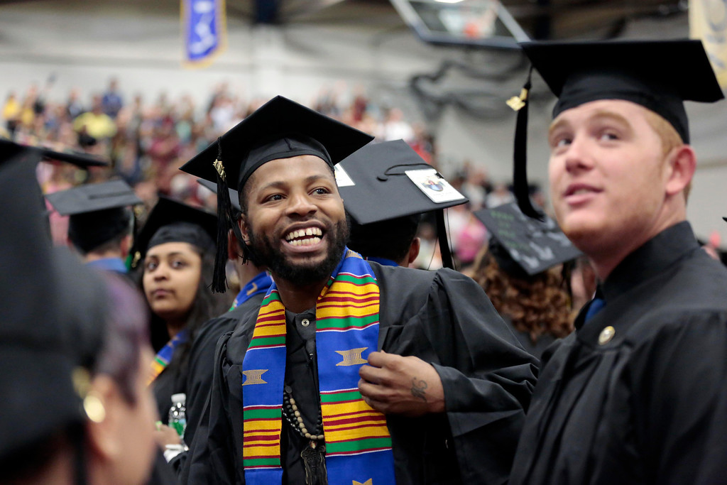 . Tyrell Mosley looks up to the crowd as the graduates enter the gymnasium for the MCLA commencement ceremony in North Adams. Saturday, May 17, 2014.