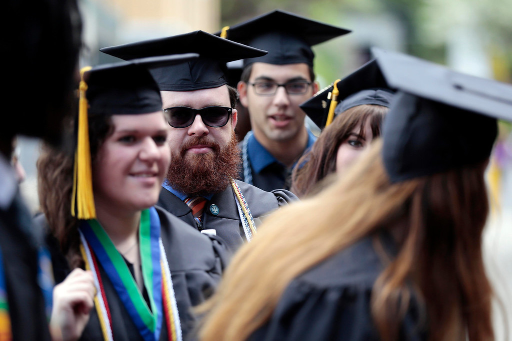 . Graduates line up to enter the gymnasium for the MCLA commencement ceremony in North Adams. Saturday, May 17, 2014.