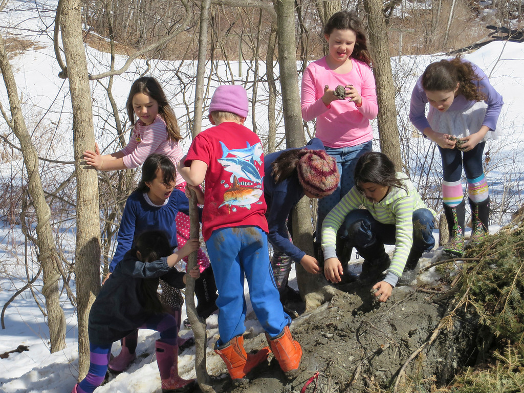 . Third graders explore the spring mud and snow Tuesday at the Great Barrington Rudolf Steiner School. Jenn Smith/ Berkshire Eagle Staff/ photos.berkshireeagle.com Tuesday, March 11, 2013
