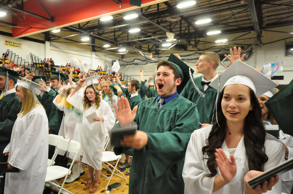 . Center from left, Mitchell Malloy and Madilyn Luczynski celebrate during graduation exercises of McCann Technical School in the Amsler Campus Center at MCLA on Wednesday, June 4, 2014. Gillian Jones / Berkshire Eagle Staff / photos.berkshireeagle.com
