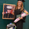 Gillian Jones/North Adams Transcript <br /> Jamie Czarnecki, a graduate in the cosmetology program at McCann Technical High School, holds up a larger than life photo of her husband Brandon, a private first class in the marines. The two were married on May 25.