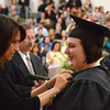 Gillian Jones/North Adams Transcript <br /> Ashley Bostic is pinned by Krista Mastroianni as a graduate in the cosmetology program at McCann Technical High School on Monday night during post-secondary graduation exercises.