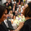 Gillian Jones/North Adams Transcript <br /> Courtney T. Sage is pinned by Krista Mastroianni as a graduate in the cosmetology program at McCann Technical High School on Monday night during post-secondary graduation exercises.