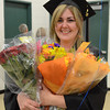 Gillian Jones/North Adams Transcript <br /> Jennifer Racine, a graduate of the medical assisting program at McCann Technical High School, holds about a half dozen bouquets of flowrs on Monday night following post-secondary graduation exercises.