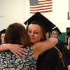 Gillian Jones/North Adams Transcript <br /> Heather Malloy hugs Terry LeClair after being pinned as a graduate in the medical assisting program at McCann Technical High School on Monday night. for post-secondary graduation exercises for 30.
