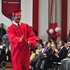 Jack Guerino/ North Adams Transcript<br /> Henry Barrett receives his diploma and waves to family and friends in the crowd during graduation at Mt. Greylock Regional High School Saturday.
