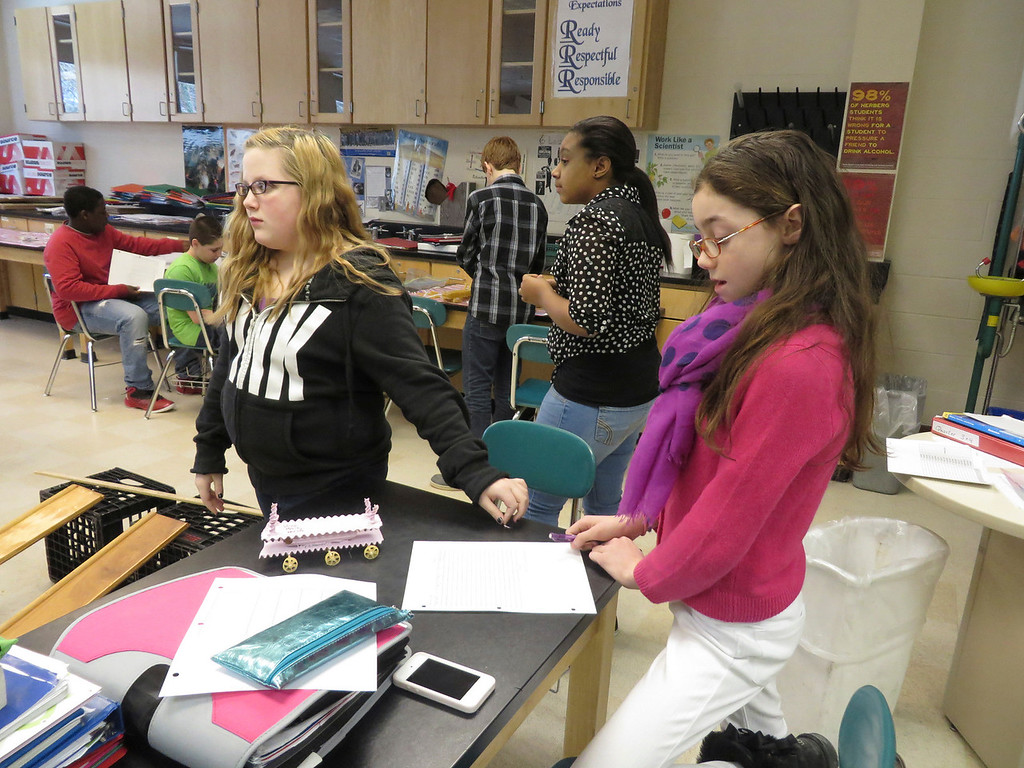 """. From left: Herberg Middle School seventh graders Ava Bressette, Perla Rojas and Hailey Sumner prepare to race their \""""pasta pod,\"""" they constructed as part of a physics lesson. The girls painted their vehicle lavender. Jenn Smith/Berkshire Eagle Staff/ photos.berkshireeagle.com Friday, March 7, 2014"""