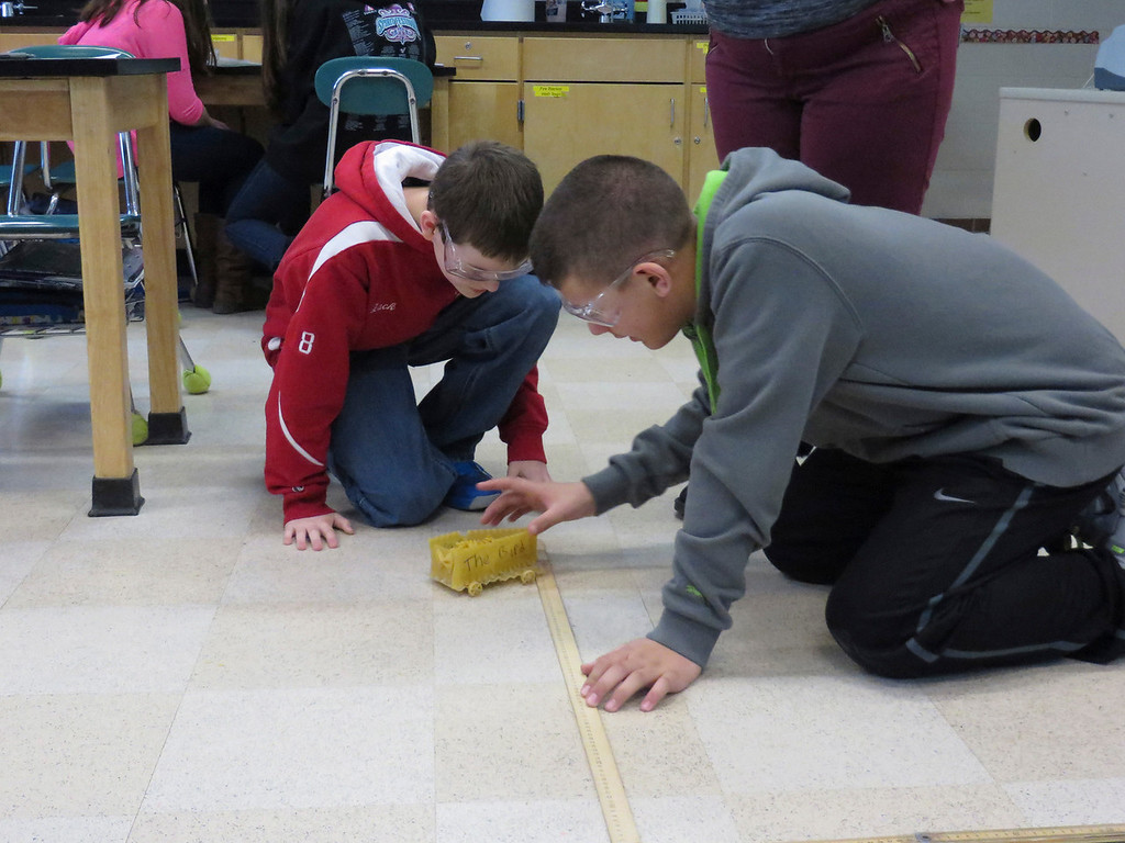 """. Herberg Middle School seventh graders Zack Zerbato (left) and Hunter Potash (right), discuss the design of their \""""pasta pod,\"""" a racing vehicle the created as part of a physics lesson. Jenn Smith/Berkshire Eagle Staff/ photos.berkshireeagle.com Friday, March 7, 2014"""