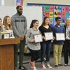 JENN SMITH — THE BERKSHIRE EAGLE <br /> Reid Middle School eighth-grader S.A.Y. It Proud Award winners Kileigh McGann and Caitlyn Mayhew, with Pittsfield Prevention Partnership coordinator, Richard Johnson, recipients Gianna Arace, Ellianna Christopher and Benjamin Vengalil, with Principal Linda Whitacre.
