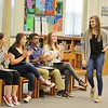 JENN SMITH — THE BERKSHIRE EAGLE <br /> Fellow Reid Middle School eighth-graders applaud their classmate, Caitlyn Mayhew, as she walk over to receive a S.A.Y. It Proud Award for her dedication to the school's chapter of Students Against Destructive Decisions (S.A.D.D.).