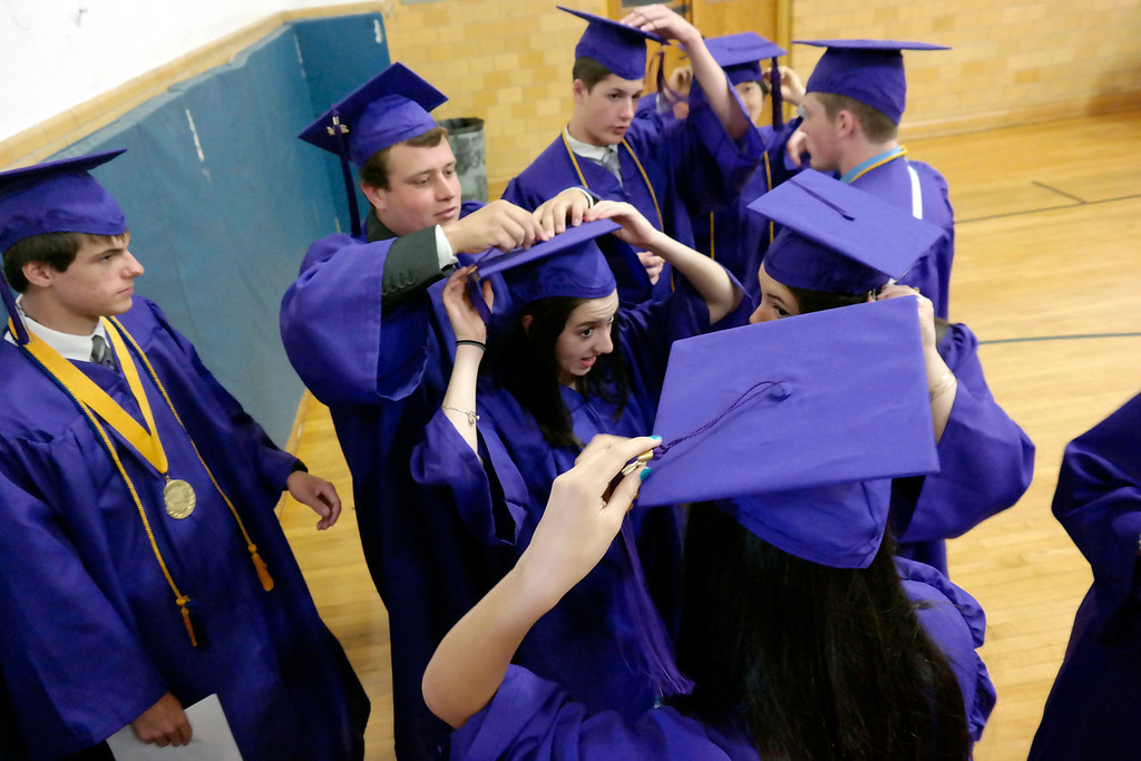 . St Josephprepare for graduation, Sunday June 1, 2014.  Ben Garver / Berkshire Eagle Staff / photos.berkshireeagle.com