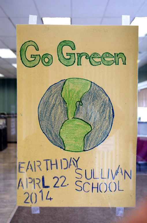 . One of the Earth Day posters made by a sixth grader in Jim Holmes\' s class at Sullivan School hangs in the window of the Berkshire Eagle and other storefronts in downtown North Adams on Wednesday, April, 16, 2014. Gillian Jones / Berkshire Eagle Staff / photos.berkshireeagle.com