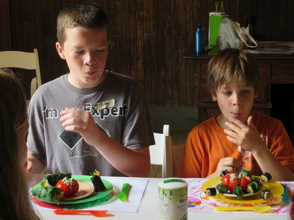 . From left: Liam Nester, 13, and Theo Maurino, 10, bite into the \'sushi\' rolls they made with a mix of vegetables, seeds and grains during The Nutrition Center\'s Food Adventures summer camp at The Mount in Lenox. Jenn Smith/Berkshire Eagle Staff/photos.berkshireeagle.com Thursday, July 3, 2014