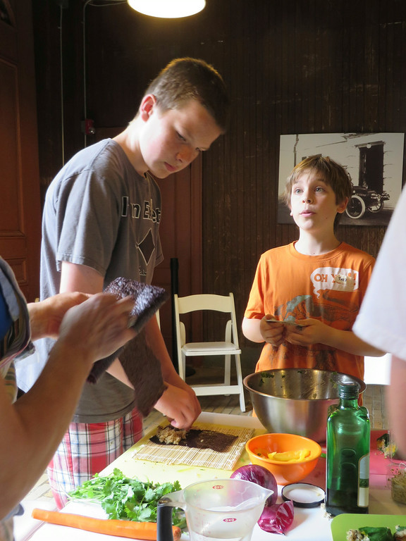 . Liam Nester, 13 (left) and Theo Maurino, 10, watch and learn how to make nori rolls in The Nutrition Center\'s Food Adventures summer camp at The Mount in Lenox. Jenn Smith/Berkshire Eagle Staff/photos.berkshireeagle.com Thursday, July 3, 2014