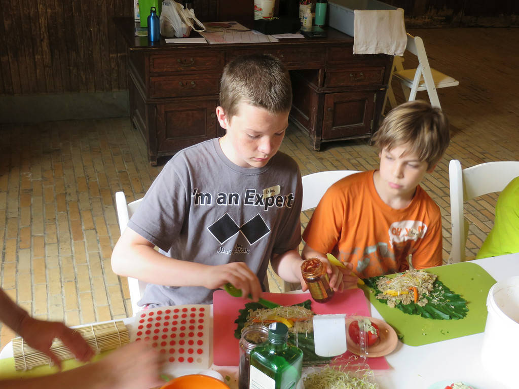 . Liam Nester, 13, and Theo Maurino, 10, add a hot sauce to their vegetable and grain sushi rolls made in The Nutrition Center\'s Food Adventures summer camp at The Mount in Lenox. Jenn Smith/Berkshire Eagle Staff/photos.berkshireeagle.com Thursday, July 3, 2014