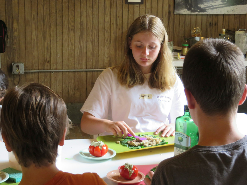 . Ashley Wellenkamp, 11, spreads mixed grains onto a collard green leaf to make \'sushi\' rolls during The Nutrition Center\'s Food Adventures summer camp at The Mount in Lenox. Jenn Smith/Berkshire Eagle Staff/photos.berkshireeagle.com Thursday, July 3, 2014