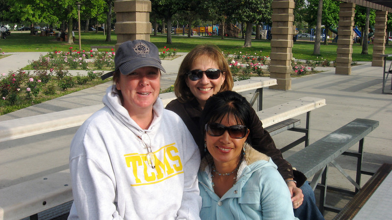 Moms cheer cubs on from bleachers--Mrs. Hammel, Mrs. Jabbari, and Mrs. Kracoff, April 2010