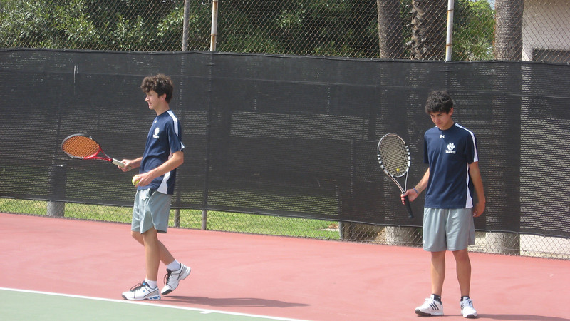 Ted Hammel and Chris Llerena warm up for St. Francis in April 2010