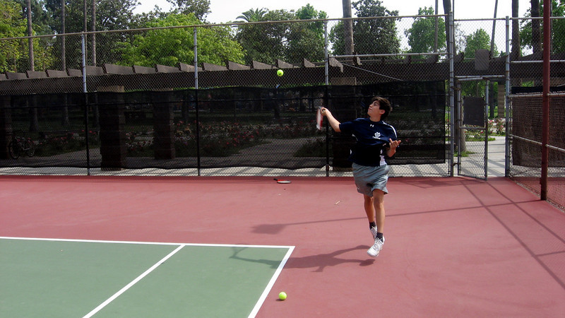 Singles ace Stephen Handal cracks a forehand in St. Francis match, April 2010