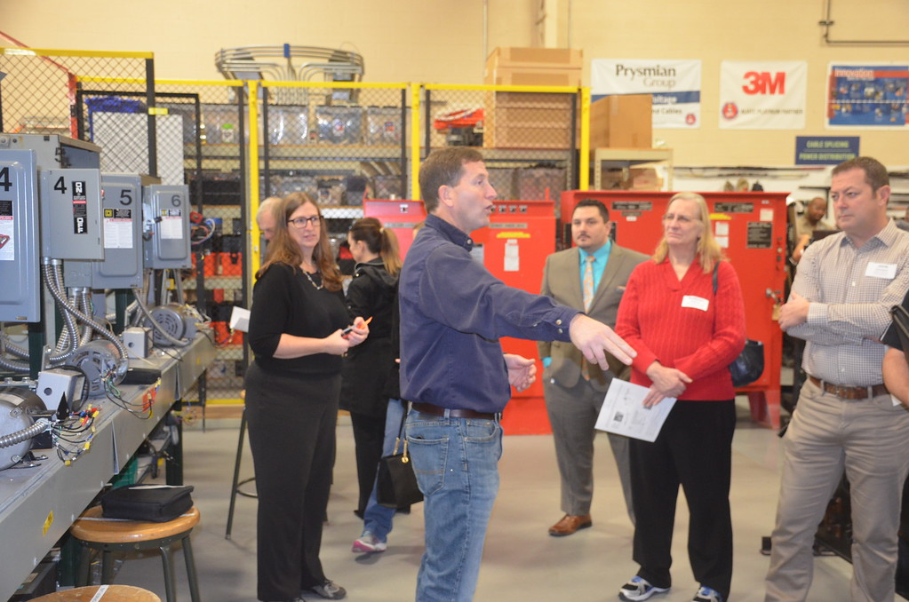 . Andrew Dueweke, an instructor at the Detroit Electrical Industry Training Center, talks to Macomb County high school counselors about skilled trades opportunities during National Apprenticeship Week.