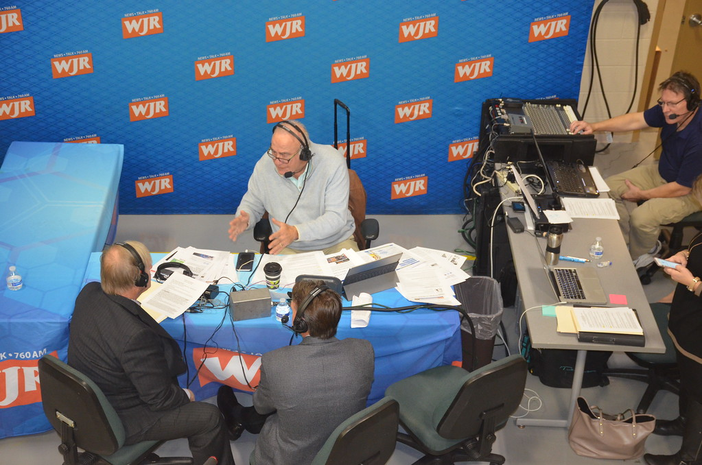 . Frank Beckmann of WJR radio (760 AM) talks to Mike DeVault, superintendent of the Macomb County Intermediate School District, left, and Macomb County Executive Mark Hackel, right.