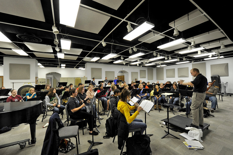 Mark Heidel conducts a rehearsal of the University of Iowa symphony band in the Music West Interim Building (originally the UI Museum of Art) on the campus of the University of Iowa, 10/16/09.